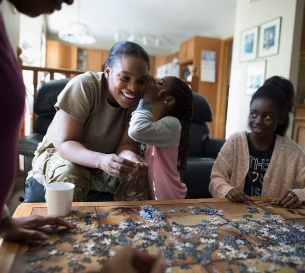 image of military mom building puzzle with two young daughters